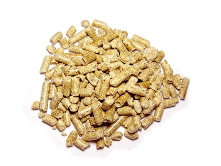 Wood pellets background close up. Isolated in white photo
