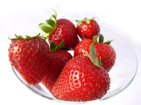 tasteful: Red and tasteful succulent strawberries, in a glass plate isolated in white. Stock Photo