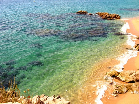 blue water ripple: Rocks, and blue water in a natural environment (Costa Brava, Spain) Stock Photo