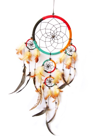 native american art: A red, green and black dreamcatcher isolated in white. Stock Photo