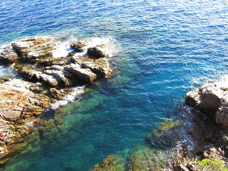 Rocks, and blue water in a natural environment (Costa Brava, Spain) photo