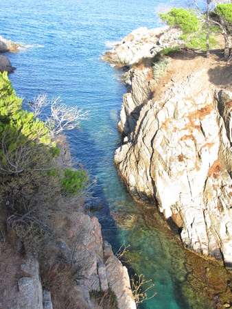 Rocks, and blue water in a natural environment (Costa Brava, Spain) Stock Photo - 10503322