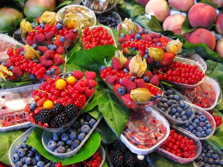 Fruits market (La Boqueria,Barcelona famous marketplace). Red and black berries Stock Photo
