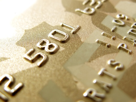 Numbers of golden credit card in very close up Stock Photo