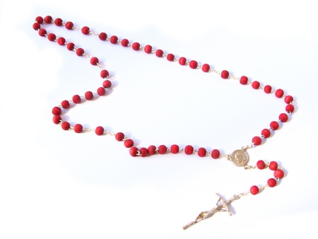 Red rosary made of rose