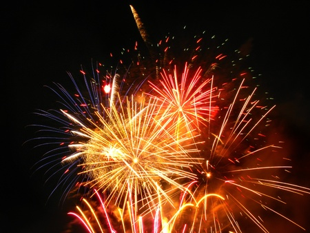 Colorful fireworks over dark sky, displayed during a celebration Stock Photo