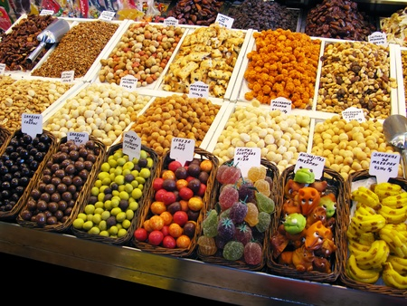 Sweets, candies and dried fruits in La Boqueria (Barcelona famous market)