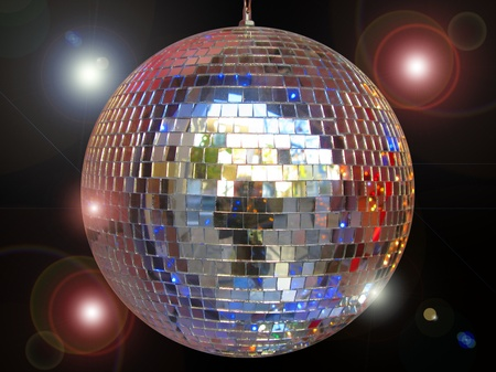 Disco ball with sparkles isolated in black photo