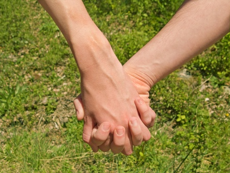 Two hands over green nature background. Love and friendship concept Stock Photo - 10681966