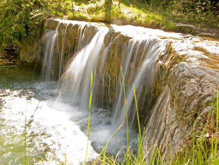 Beautiful waterfall in the rocks. Fresh and clean little river, a relaxing place in the mountain Stock Photo
