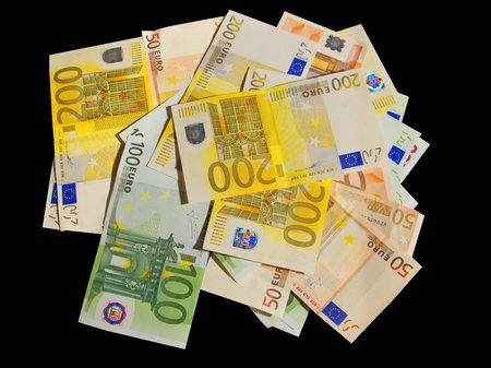 one hundred euro banknote: Different euro bills isolated in black