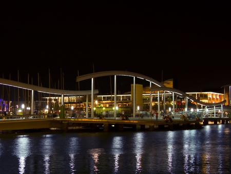 A general view of Barcelona port and bridge at night, with reflection lights