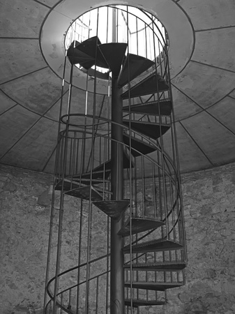 Vertical spiral staircase picture in black and white photo