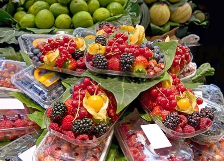 Fruits market (La Boqueria,Barcelona famous marketplace). Red and black berries photo
