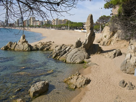 Beautiful beach and blue water at Costa Brava (Spain) photo