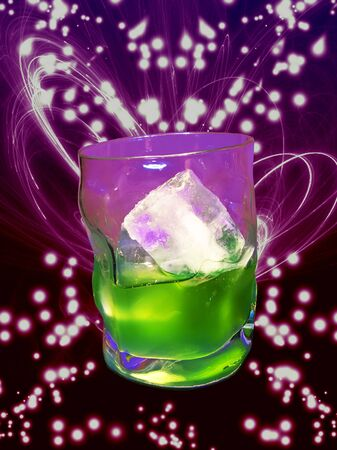 A peppermink drink in a glass, over colorful abstract background photo