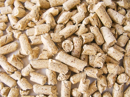 Wood pellets background close up Stock Photo