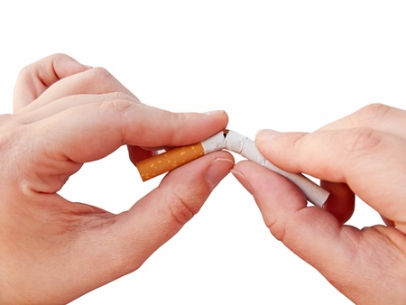 Hands breaking a cigarette, isolated in white