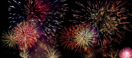 Colorful fireworks over dark sky during a celebration Stock Photo