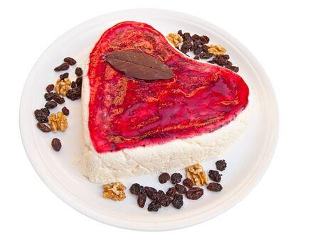 Heart shaped cake isolated on white photo
