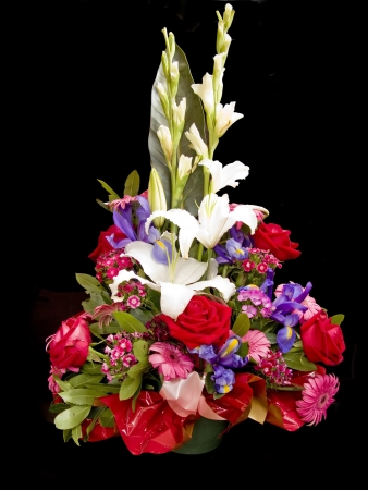 occasion: Different flowers bouquet in a basket, isolated in black