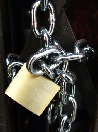 Key lock locked with a chain, in black Stock Photo - 12004571
