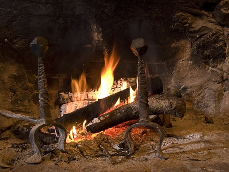 Warming fireplace in winter, at home. Close up of flames and firewood Stock Photo - 12019038