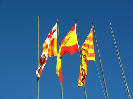 catalonia: Barcelona,Spain and Catalonia flags over blue sky