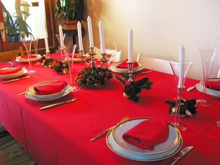 Christmas table in red with typical decoration Stock Photo
