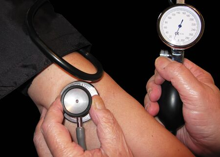 Measuring the blood pressure  Isolation in black photo