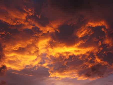 Dramatic sunset like fire in the sky with golden clouds photo