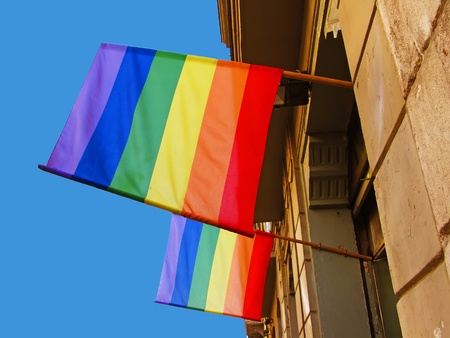 flagging: Rainbow flags in a building in Barcelona