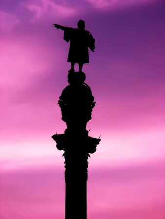 Barcelona Christopher Columbus statue over purple sunset photo