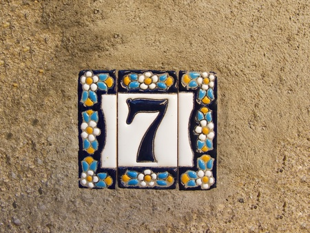 Number seven in a ceramic tile on street photo