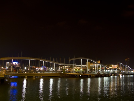 A general view of Barcelona port and bridge at night, with reflection lights photo