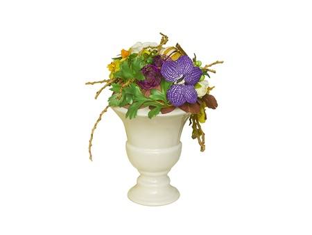 Decorative vase with flowers and nature items photo