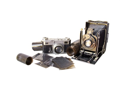 negatives: A very old camera (from the beginning of the XXth century) set with another old camera (from the fifties) and old film and negatives.