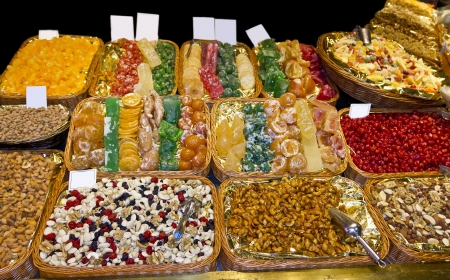 Sweets, candies and dried fruits in La Boqueria (Barcelona famous market) photo