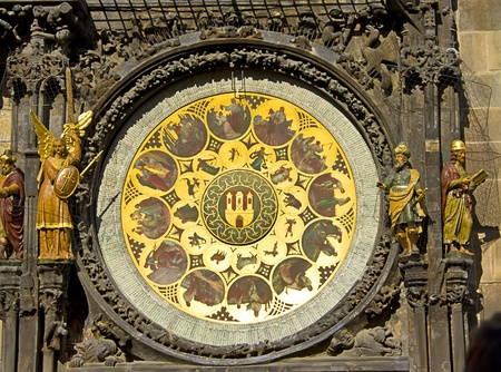 Detail on Astronomical Clock (Prague Orloj) located in The clock tower and a dove flying in front of it. Prague, Czech Republic photo
