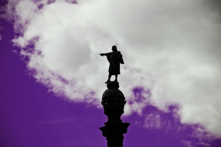 christopher columbus: Statue of Christopher Columbus pointing America in Barcelona  Spain  over a cloudy sky