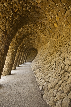 guell: Arcade of masonry stone columns in Park Guell Barcelona of Gaudi modernism