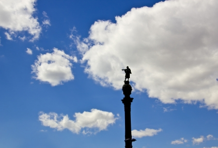 christopher columbus: Statue of Christopher Columbus pointing America in Barcelona (Spain) over a cloudy sky Stock Photo