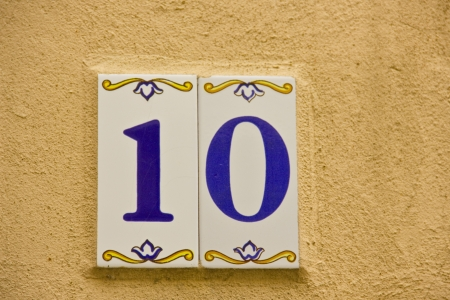 number 10: Number ten in a ceramic tile on street