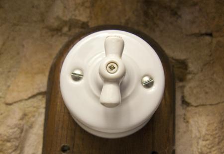 bakelite: Vintage switch. Antiquated old bakelite white switch