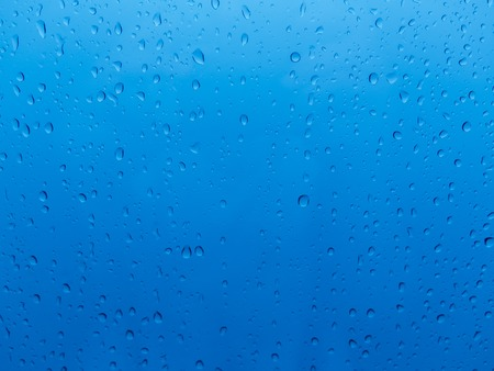 Water drops on a blue background Stock Photo