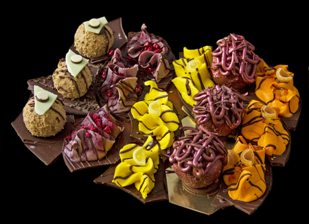 Different homemade sweets isolated on black