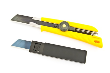 The yellow cutter and blade on white background Stock Photo