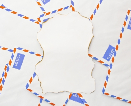 The paper burn  on envelope mail background