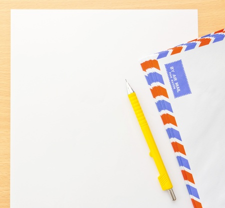 Paper and envelope mail on wood background