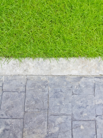 Close up of street and grass background